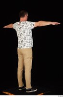 Spencer black sneakers brown trousers dressed standing t poses white printed t shirt whole body 0006.jpg