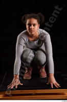 Zahara  1 brown workers dressed grey sweatshirt grey trousers kneeling whole body 0001.jpg