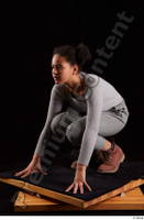 Zahara  1 brown workers dressed grey sweatshirt grey trousers kneeling whole body 0002.jpg