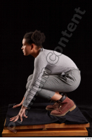Zahara  1 brown workers dressed grey sweatshirt grey trousers kneeling whole body 0003.jpg