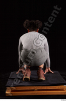 Zahara  1 brown workers dressed grey sweatshirt grey trousers kneeling whole body 0005.jpg