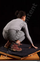 Zahara  1 brown workers dressed grey sweatshirt grey trousers kneeling whole body 0006.jpg
