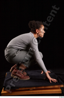 Zahara  1 brown workers dressed grey sweatshirt grey trousers kneeling whole body 0007.jpg