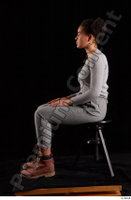 Zahara  1 brown workers dressed grey sweatshirt grey trousers sitting whole body 0001.jpg