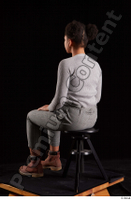 Zahara  1 brown workers dressed grey sweatshirt grey trousers sitting whole body 0002.jpg