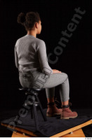 Zahara  1 brown workers dressed grey sweatshirt grey trousers sitting whole body 0004.jpg