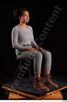 Zahara  1 brown workers dressed grey sweatshirt grey trousers sitting whole body 0006.jpg