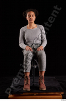 Zahara  1 brown workers dressed grey sweatshirt grey trousers sitting whole body 0007.jpg