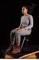 Zahara  1 brown workers dressed grey sweatshirt grey trousers sitting whole body 0008.jpg