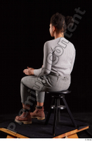 Zahara  1 brown workers dressed grey sweatshirt grey trousers sitting whole body 0010.jpg