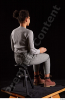 Zahara  1 brown workers dressed grey sweatshirt grey trousers sitting whole body 0012.jpg