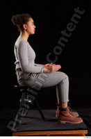 Zahara  1 brown workers dressed grey sweatshirt grey trousers sitting whole body 0013.jpg