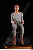 Zahara  1 brown workers dressed grey sweatshirt grey trousers sitting whole body 0015.jpg