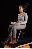 Zahara  1 brown workers dressed grey sweatshirt grey trousers sitting whole body 0016.jpg