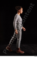 Zahara  1 brown workers grey sweatshirt grey trousers side view walking whole body 0002.jpg