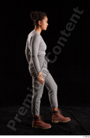 Zahara  1 brown workers grey sweatshirt grey trousers side view walking whole body 0003.jpg