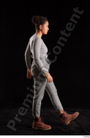 Zahara  1 brown workers grey sweatshirt grey trousers side view walking whole body 0004.jpg