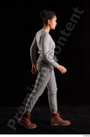 Zahara  1 brown workers grey sweatshirt grey trousers side view walking whole body 0005.jpg