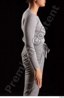 Zahara  1 arm dressed flexing grey sweatshirt side view 0001.jpg