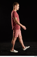 Max Dior  1 dressed red shorts red t shirt side view walking white loafers whole body 0004.jpg