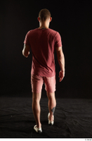 Max Dior  1 back view dressed red shorts red t shirt walking white loafers whole body 0001.jpg