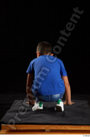Timbo  1 blue t shirt dressed jeans shorts kneeling white sneakers whole body 0005.jpg