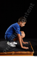 Timbo  1 blue t shirt dressed jeans shorts kneeling white sneakers whole body 0007.jpg