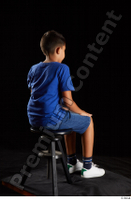 Timbo  1 blue t shirt dressed jeans shorts sitting white sneakers whole body 0004.jpg