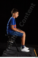 Timbo  1 blue t shirt dressed jeans shorts sitting white sneakers whole body 0005.jpg