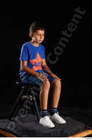 Timbo  1 blue t shirt dressed jeans shorts sitting white sneakers whole body 0006.jpg