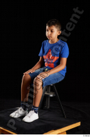 Timbo  1 blue t shirt dressed jeans shorts sitting white sneakers whole body 0008.jpg