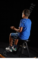 Timbo  1 blue t shirt dressed jeans shorts sitting white sneakers whole body 0010.jpg