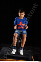 Timbo  1 blue t shirt dressed jeans shorts sitting white sneakers whole body 0015.jpg