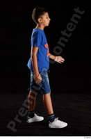 Timbo  1 blue t shirt dressed jeans shorts side view walking white sneakers whole body 0001.jpg