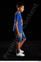 Timbo  1 blue t shirt dressed jeans shorts side view walking white sneakers whole body 0003.jpg