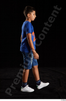 Timbo  1 blue t shirt dressed jeans shorts side view walking white sneakers whole body 0004.jpg