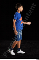 Timbo  1 blue t shirt dressed jeans shorts side view walking white sneakers whole body 0005.jpg