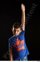 Timbo  1 arm blue t shirt dressed flexing front view 0012.jpg