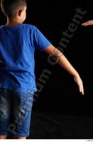 Timbo  1 arm back view blue t shirt dressed flexing 0004.jpg