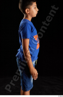 Timbo  1 arm blue t shirt dressed flexing side view 0001.jpg