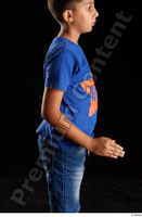 Timbo  1 arm blue t shirt dressed flexing side view 0002.jpg