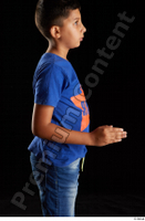 Timbo  1 arm blue t shirt dressed flexing side view 0003.jpg