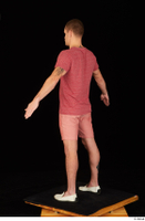 Max Dior casual dressed red shorts red t shirt standing white loafers whole body 0012.jpg