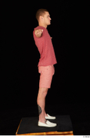 Max Dior casual dressed red shorts red t shirt standing t poses white loafers whole body 0007.jpg