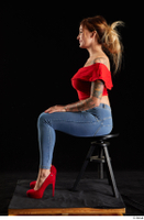 Daisy Lee  1 blue jeans dressed red high heels red top sitting whole body 0001.jpg