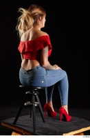 Daisy Lee  1 blue jeans dressed red high heels red top sitting whole body 0004.jpg