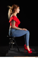 Daisy Lee  1 blue jeans dressed red high heels red top sitting whole body 0005.jpg