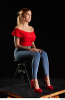 Daisy Lee  1 blue jeans dressed red high heels red top sitting whole body 0006.jpg
