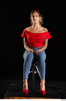 Daisy Lee  1 blue jeans dressed red high heels red top sitting whole body 0007.jpg