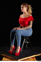 Daisy Lee  1 blue jeans dressed red high heels red top sitting whole body 0008.jpg